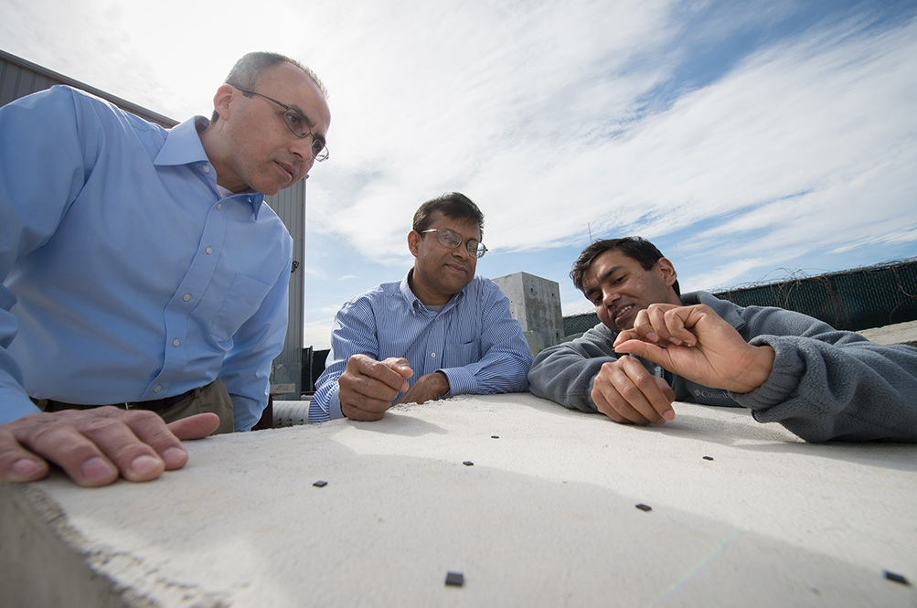 Rigoberto Burgueno, Subir Biswas, and Shantanu Chakrabartty are developing a new technology known as substrate computing at Michigan State University. This will allow sensing, communication and diagnostic computing, all within the substrate – the building material – of a structure, using energy harvested from the structure itself. (Photo courtesy of MSU).