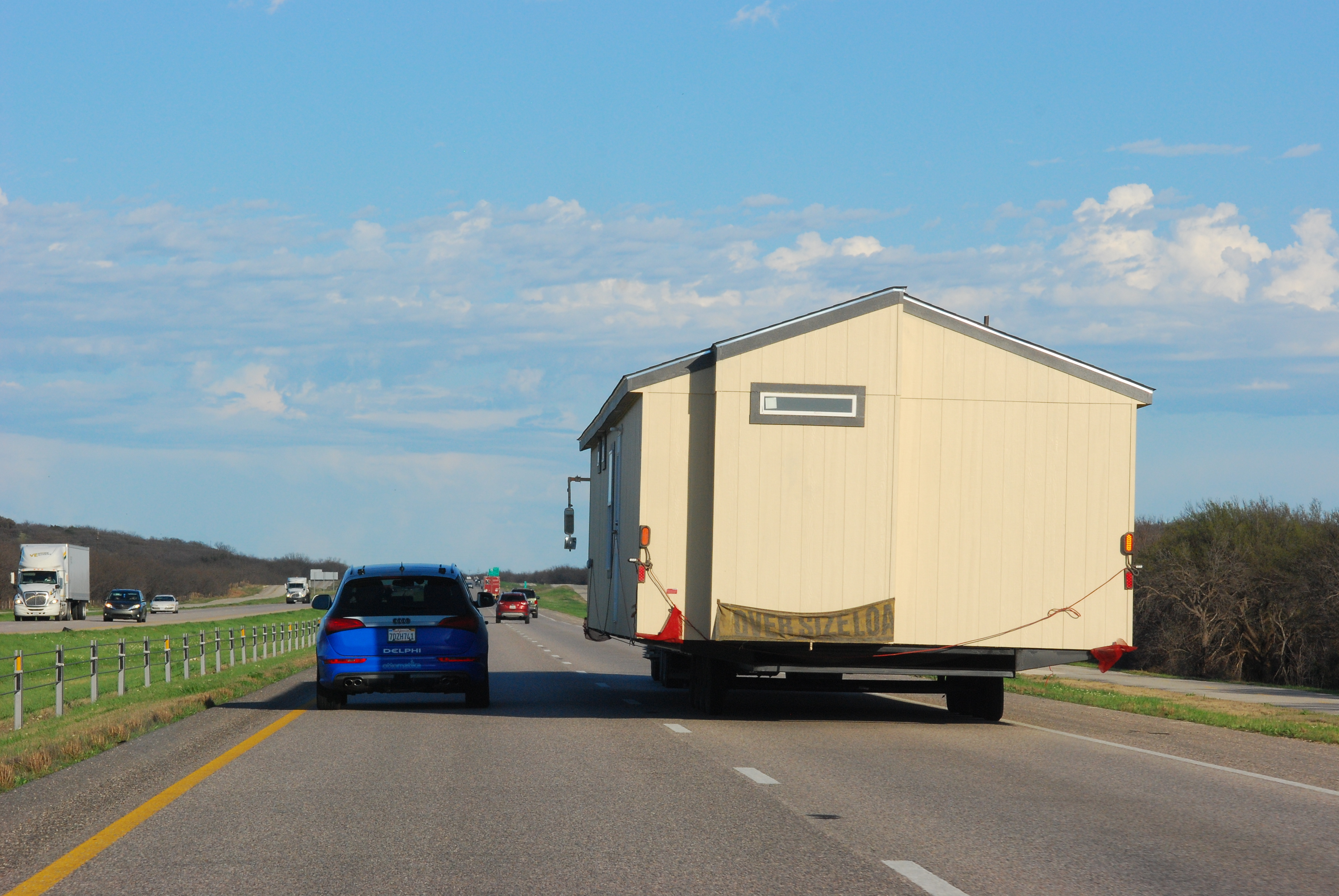 Delphi's autonomous car successfully navigates around a wide load on a freeway. Photo: BusinessWire.