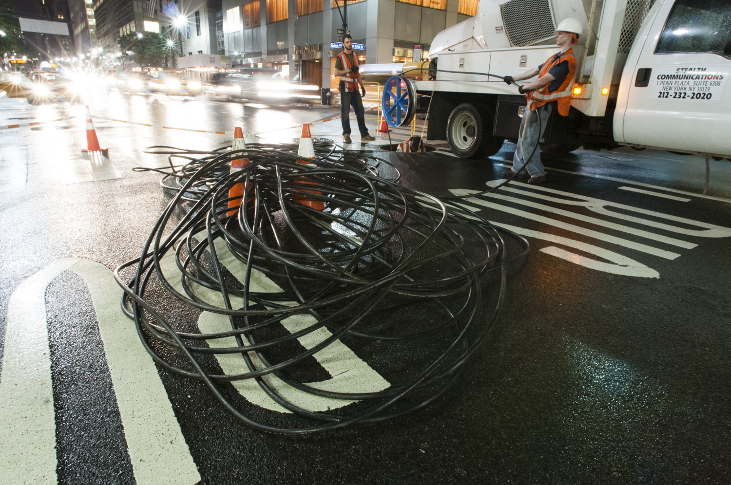 """Stealth Fiber Crew installing fiber cable underneath the streets of Manhattan"" by Shuli Hallak - Own work. Licensed under CC BY-SA 3.0 via Wikimedia Commons - http://commons.wikimedia.org/wiki/File:Stealth_Fiber_Crew_installing_fiber_cable_underneath_the_streets_of_Manhattan.jpg#/media/File:Stealth_Fiber_Crew_installing_fiber_cable_underneath_the_streets_of_Manhattan.jpg"